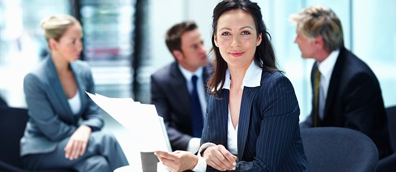 A professional administrative assistant in a meeting. Get a new career, start your Administrative Assistant Diploma Program at CCBST.