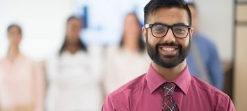 A Banking Financial professional wearing a shirt and tie. Get a new career, start your Banking and Financial CSR Diploma Program at CCBST.