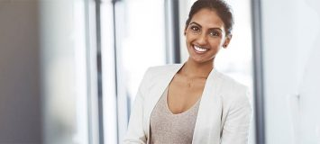 A professional Business Administration woman smiling. Get a new career, start your Business Administration, Accounting & Payroll Diploma Program at CCBST.
