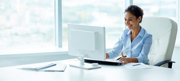 A professional accountant working at her desk in a bright office. Get a new career, start your Computerized Accounting Diploma Program at CCBST.