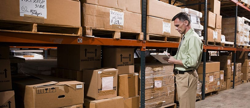 Supply Chain employee doing inventory in a warehouse.
